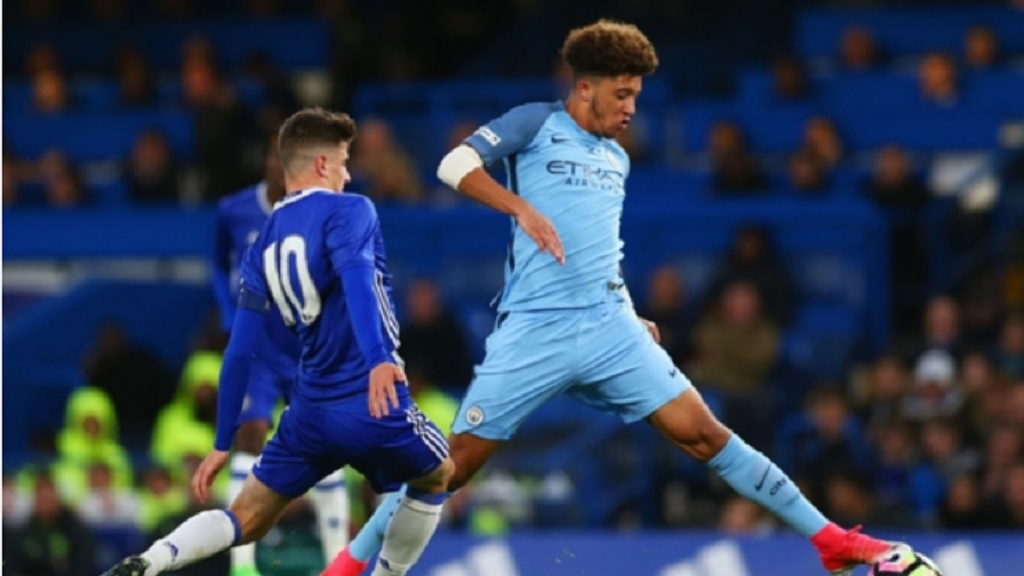 Jadon Sancho in action for Manchester City's academy.