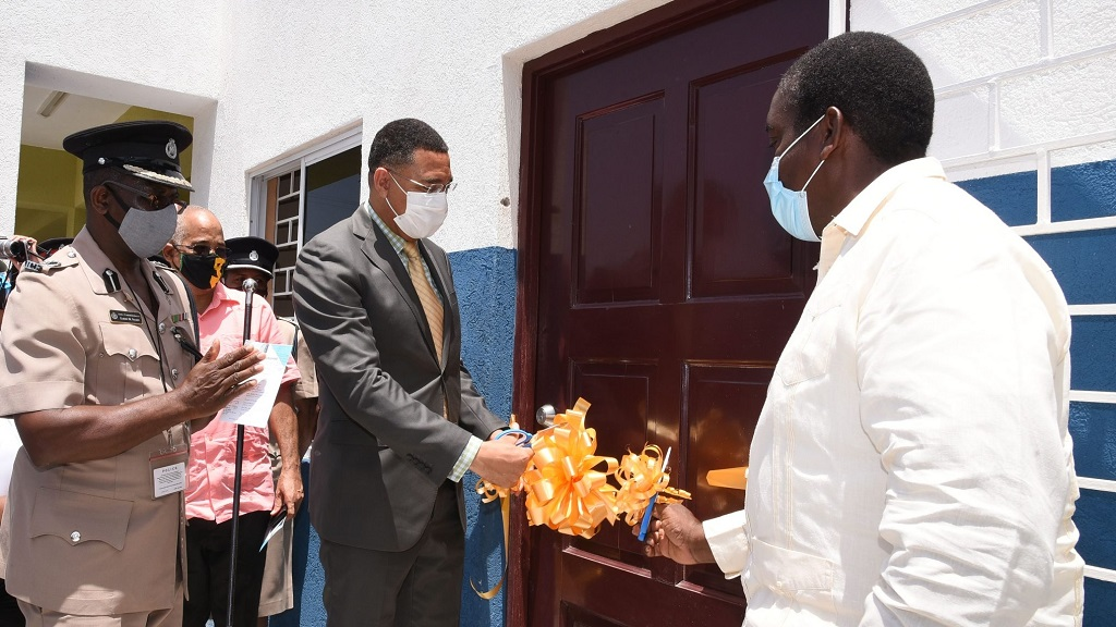 Prime Minister Andrew Holness (centre), along with Minister of Transport and Mining and Western St Mary Member of Parliament (MP), Robert Montague (right), cut the ribbon to officially open the Gayle Police Station and Multi-Purpose Centre in St Mary on Friday, July 10. Looking on is Assistant Commissioner of Police in charge of Area Two, Elbert Nelson.