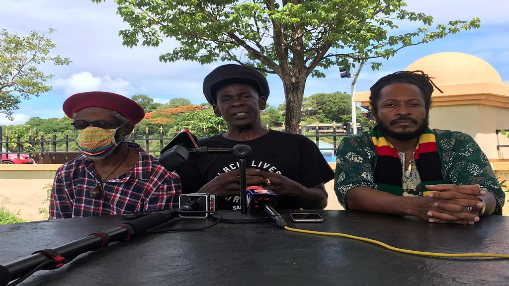 Interim Chairman of Black Lives Matter St Lucia, Peter 'Ras' Ipa Isaac (centre), ICAR president, Aaron Alexander (right)