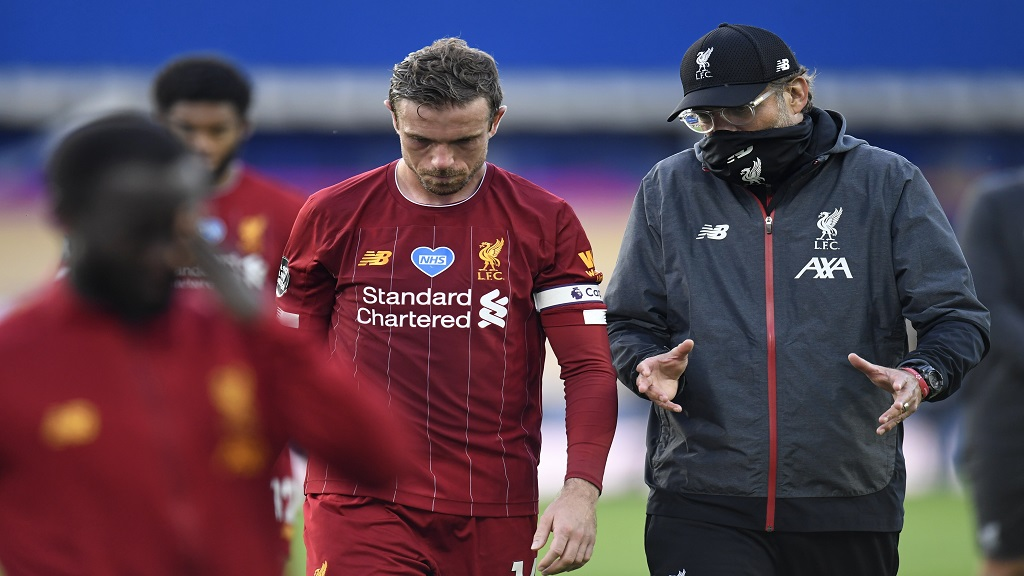 Liverpool's manager Jurgen Klopp and Jordan Henderson leave the field at the end of the English Premier League football match against Everton at Goodison Park in Liverpool, England, Sunday, June 21, 2020. (Peter Powell/Pool via AP).