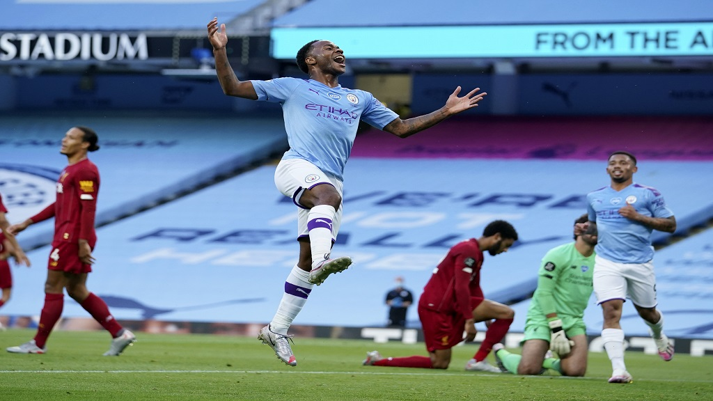 Manchester City's Raheem Sterling celebrates after scoring his team's second goal during the English Premier League football match against Liverpool at the Etihad Stadium in Manchester, England, Thursday, July 2, 2020. (AP Photo/Dave Thompson,Pool).