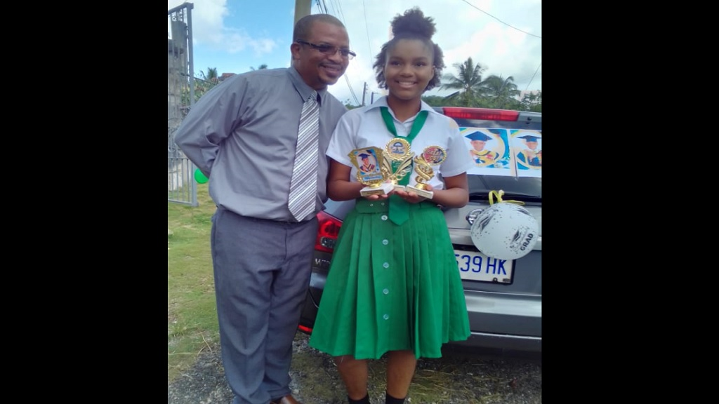 Principal of Waldensia Primary and Infant School, Claud Rowe, with Top Girl for 2020, Britney Rowe.