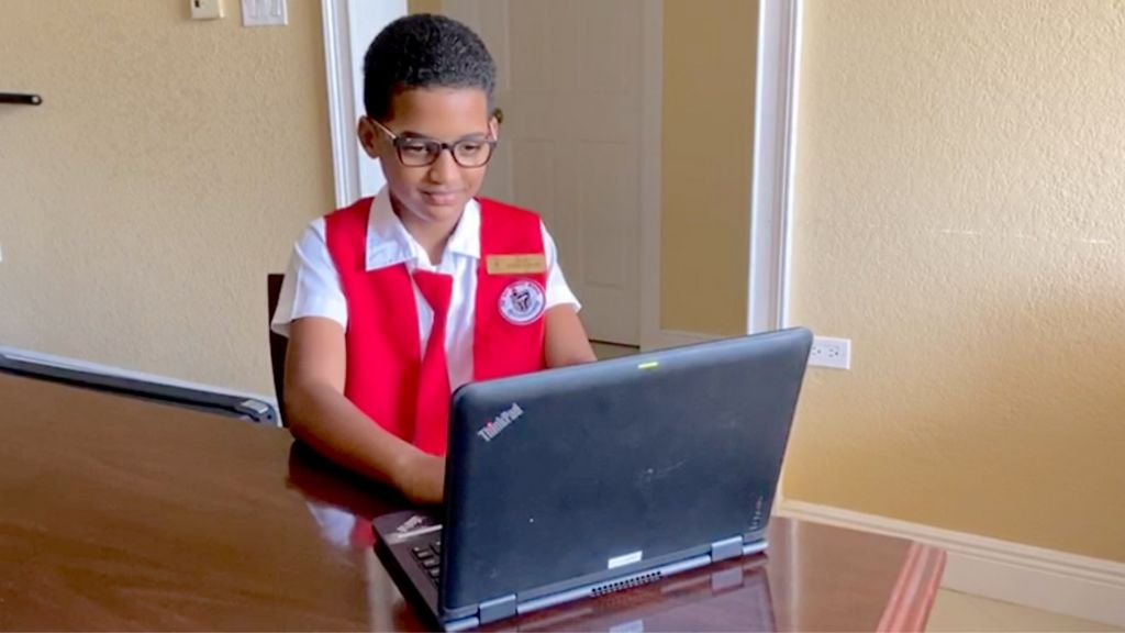 Red Bay Primary School Student, Isiah Allen works remotely on his laptop on loan.