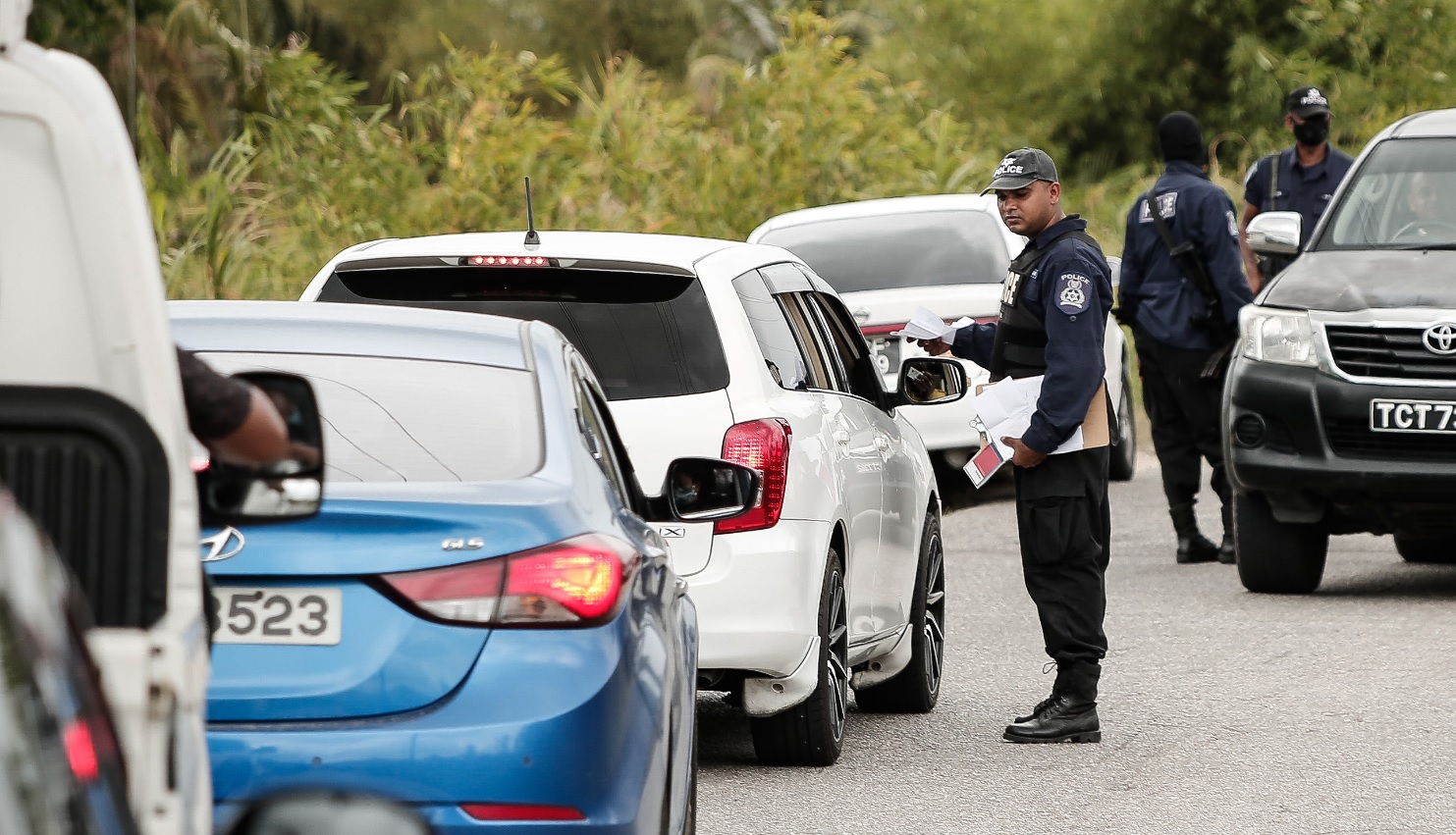 Police conduct a road exercise on Pinto Road, Arima.