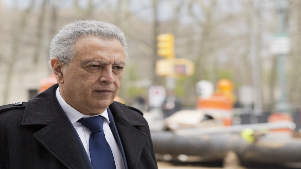 In this April 11, 2016, file photo, former FIFA vice president Alfredo Hawit leaves federal court in the Brooklyn borough of New York.  (AP Photo/Mark Lennihan, File).