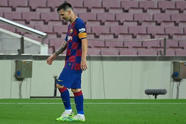 La star du Barça Lionel Messi déçu à la fin du match nul à domicile contre l'Atlético de Madrid, le 30 juin 2020 au Camp Nou LLUIS GENE AFP/Archives