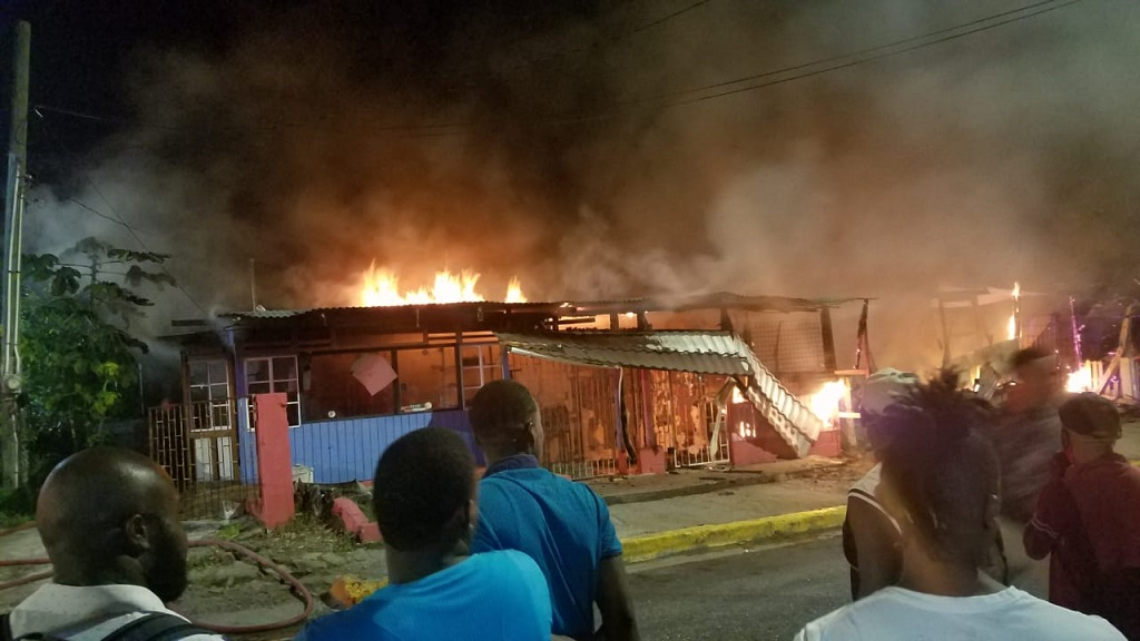 Residents of Highgate, St Mary look on as a late night/early morning fire destroyed a number of businesses in the town.