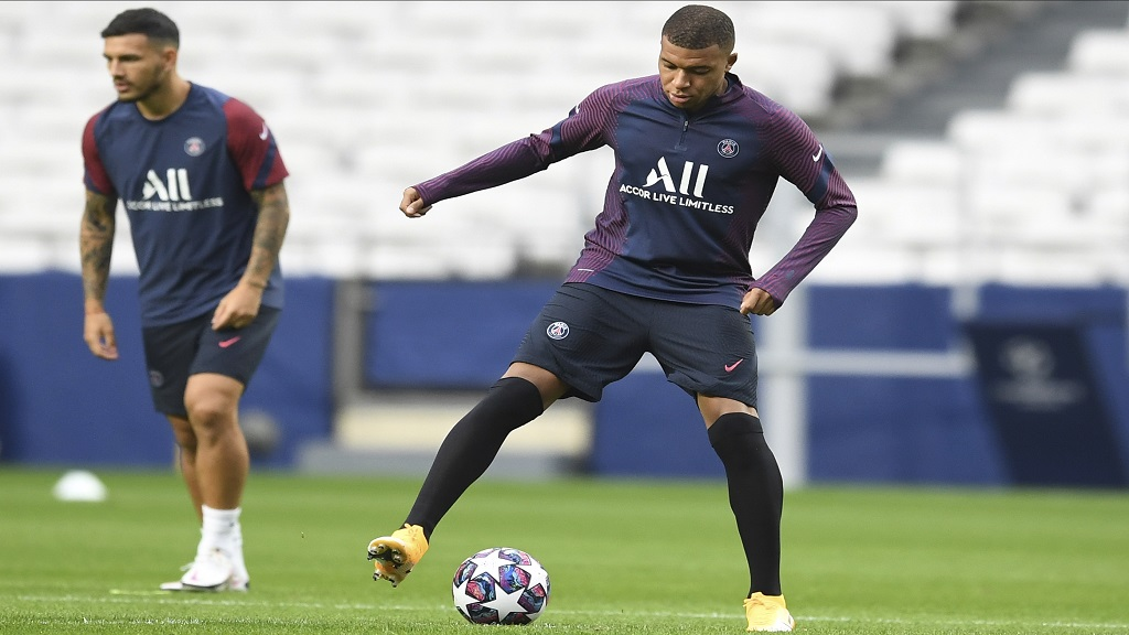 PSG's Kylian Mbappe controls the ball during a training session at the Luz stadium in Lisbon, Tuesday Aug. 11, 2020. PSG will play Atalanta in a Champions League quarterfinals football match on Wednesday. (David Ramos/Pool via AP).