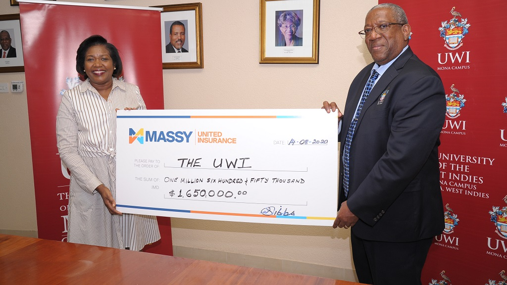 Winsome Gibbs, branch manager at Massy United Insurance recently handed over a symbolic cheque in the amount of $1.65 million to Pro Vice-Chancellor and Principal of The UWI Mona Campus, Professor Dale Webber.