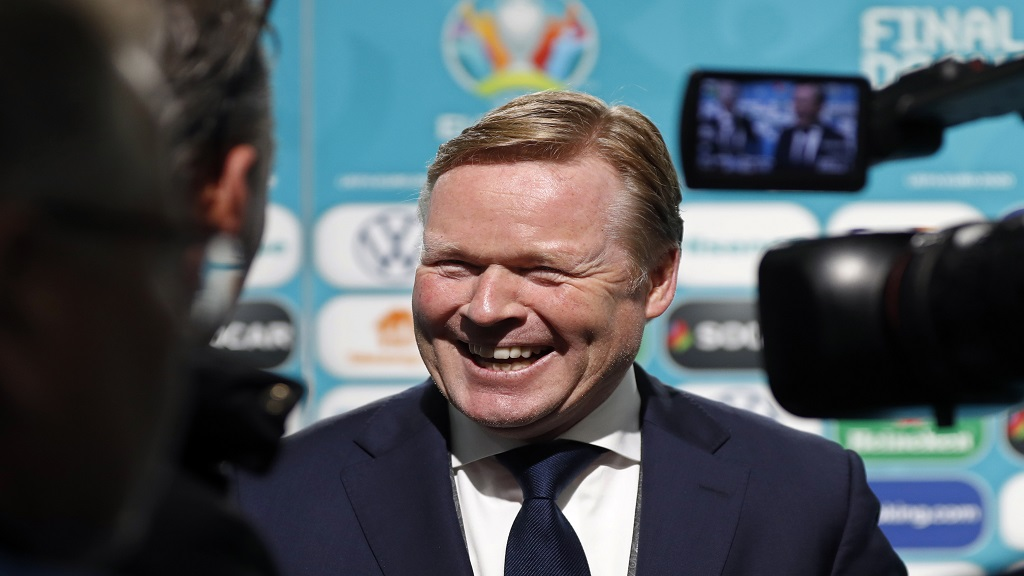 In this November 30, 2019 file photo, football coach Ronald Koeman smiles while talking to journalists after the draw for the UEFA Euro 2020 football tournament finals in Bucharest, Romania. (AP Photo/Petr David Josek, File).