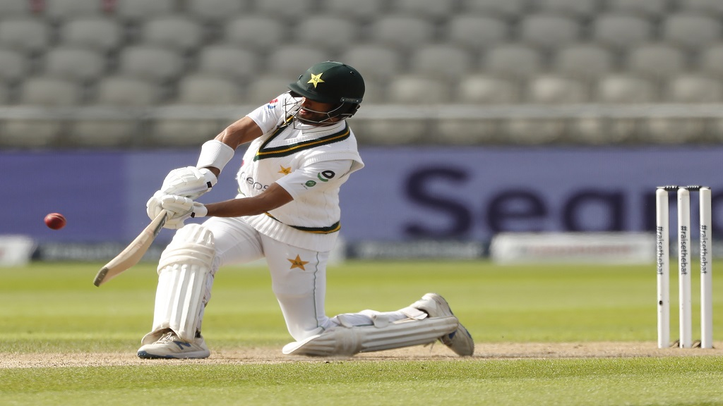 Pakistan's Shan Masood hits a six during the second day of the first cricket Test match against England at Old Trafford in Manchester, England, Thursday, Aug. 6, 2020. (Lee Smith/Pool via AP).