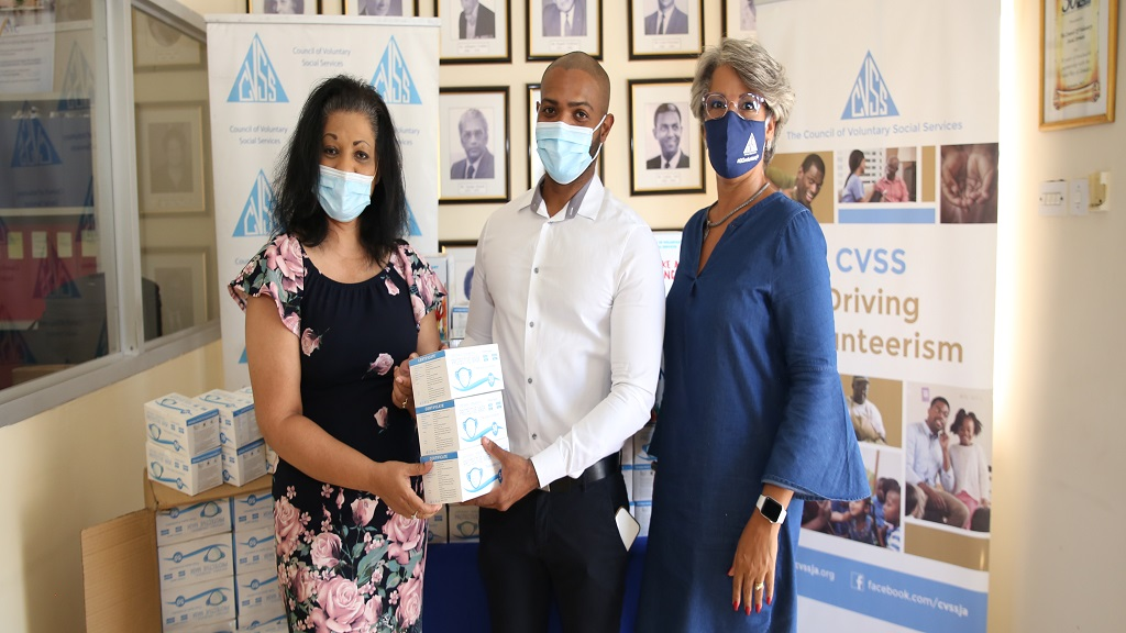 Dr David Walcott (centre), founder and managing partner of NovaMed presents protective masks to Lurline Less (left), chairperson of the Diabetes Association of Jamaica. Sharing in the moment is Kim Mair, vice-chair of the Council of Voluntary Social Services.