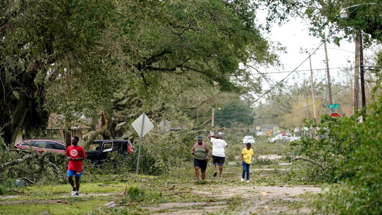 People survey the damage to their neighborhood on Thursday, Aug. 27, 2020, in Lake Charles, La., in the aftermath of Hurricane Laura. (AP Photo/Gerald Herbert)