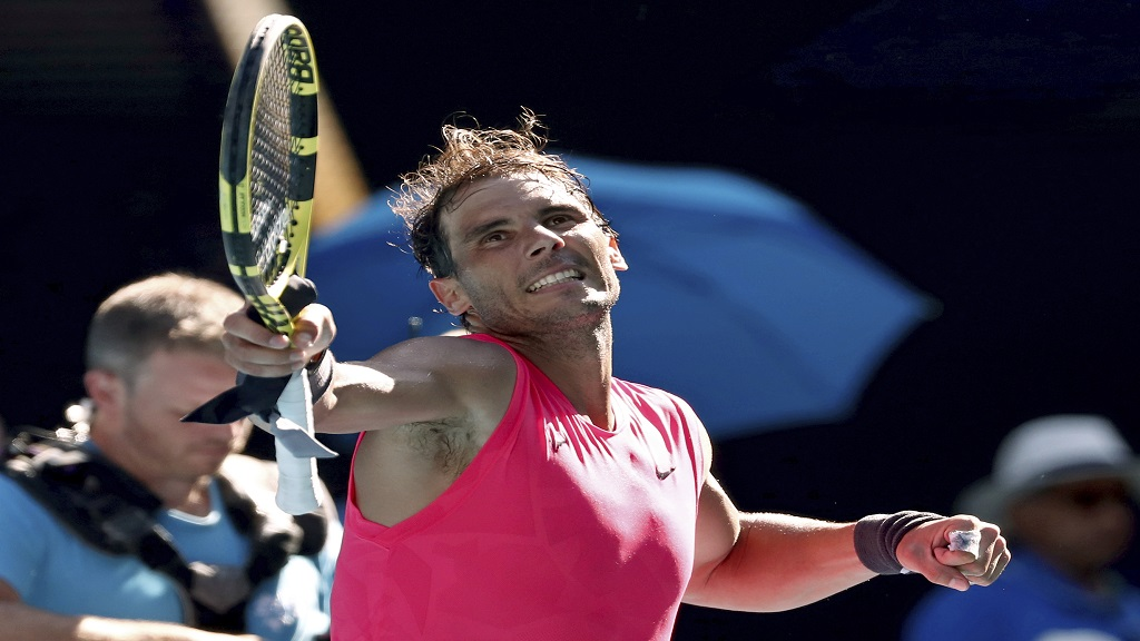Spain's Rafael Nadal celebrates after defeating compatriot Pablo Carreno Busta during their third round singles match at the Australian Open tennis championship in Melbourne, Australia, Saturday, Jan. 25, 2020. (AP Photo/Dita Alangkara).