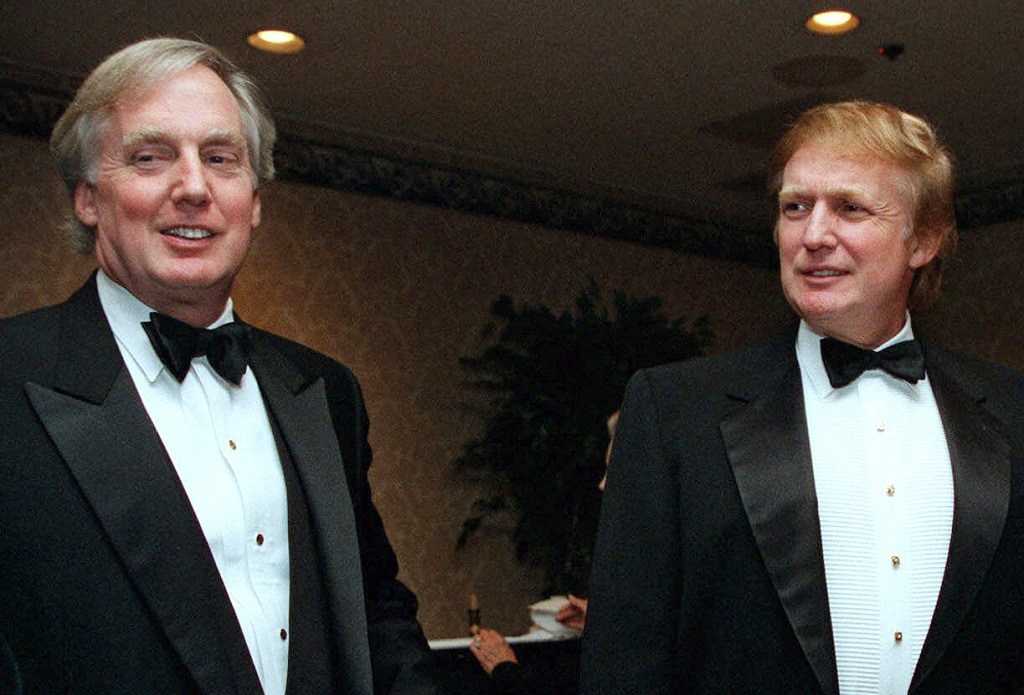 FILE - In this Nov. 3, 1999, file photo, Robert Trump, left, joins then real estate developer and presidential hopeful Donald Trump at an event in New York. President Donald Trump's younger brother, Robert Trump, a businessman known for an even keel that seemed almost incompatible with the family name, died Saturday night, Aug. 15, 2020, after being hospitalised in New York, the president said in a statement. He was 71. (AP Photo/Diane Bonadreff, File)