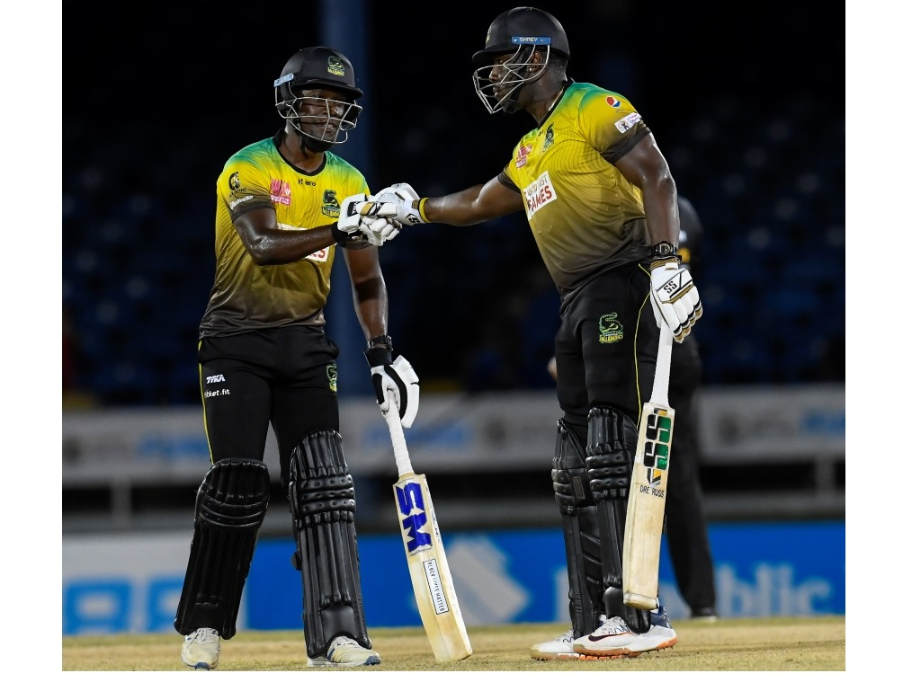 Nkrumah Bonner (left) and Andre Russell of Jamaica Tallawahs touch gloves during Match 12 of  the Hero Caribbean Premier League against Guyana Amazon Warriors at Queen's Park Oval on Tuesday, August 25, 2020. (Photo by Randy Brooks - CPL T20/CPL T20 via Getty Images).