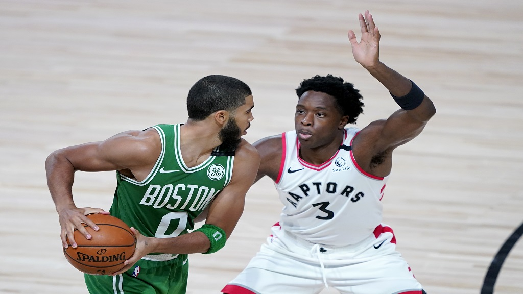 Boston Celtics' Jayson Tatum (0) works against Toronto Raptors' OG Anunoby (3) during the second half of an NBA basketball game Friday, Aug. 7, 2020 in Lake Buena Vista, Fla. (AP Photo/Ashley Landis, Pool).