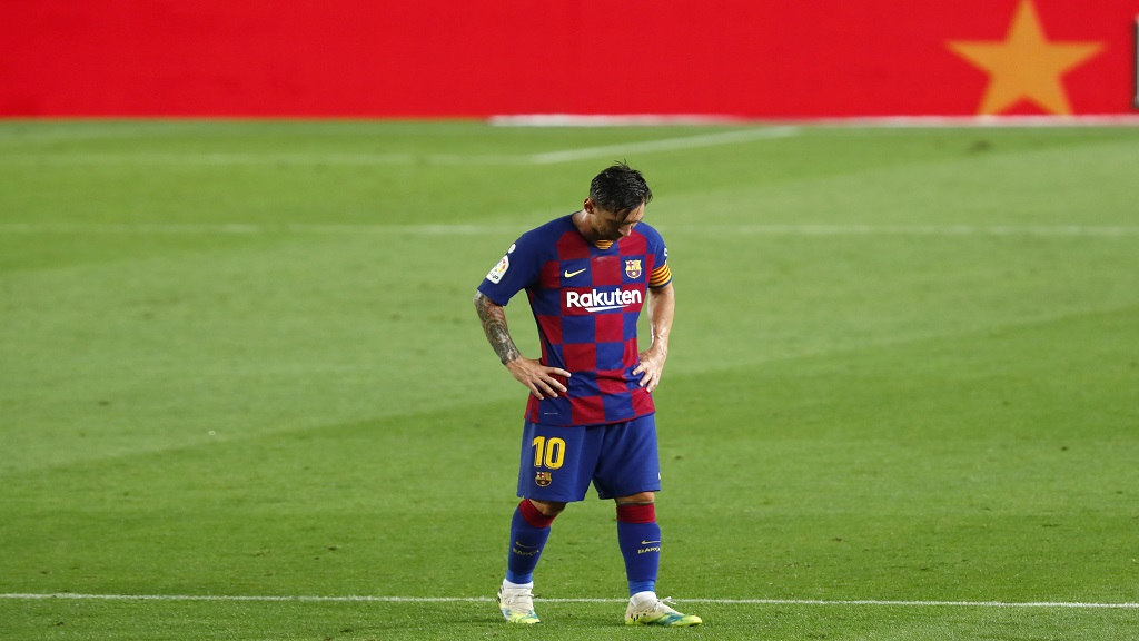 Barcelona's Lionel Messi dejected as he walks following their 2-1 defeat in a Spanish La Liga football match against Osasuna at the Camp Nou stadium in Barcelona, Spain, Thursday, July 16, 2020. (AP Photo/Joan Monfort).