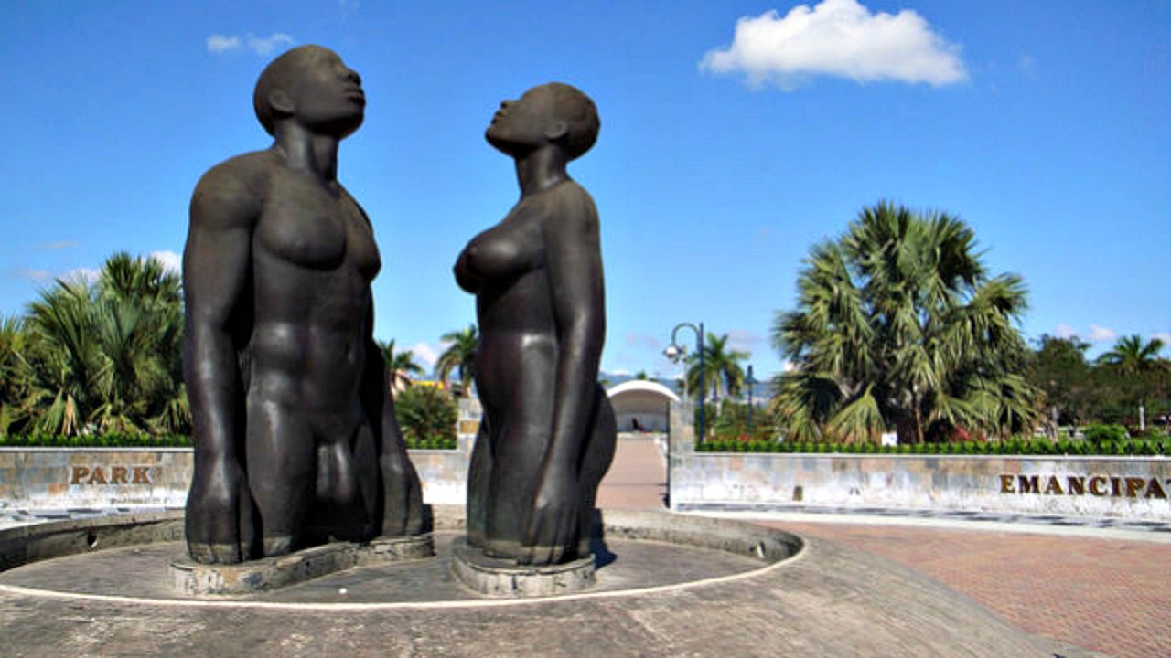 The 'Redemption Song' monument at the main entrance of Emancipation Park in Kingston, Jamaica.