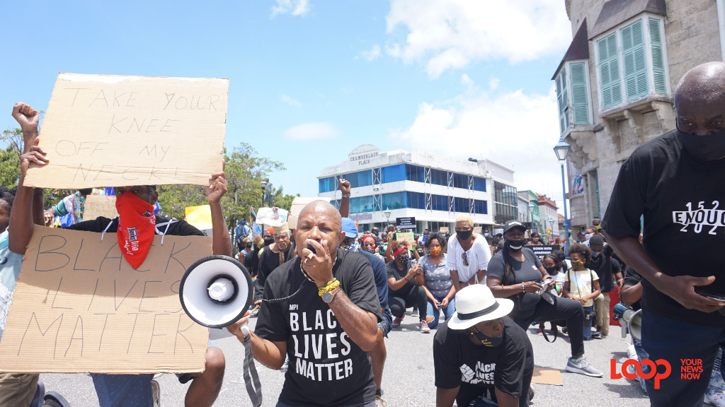 David Denny protesting at the Black Lives Matter march in front of parliament.