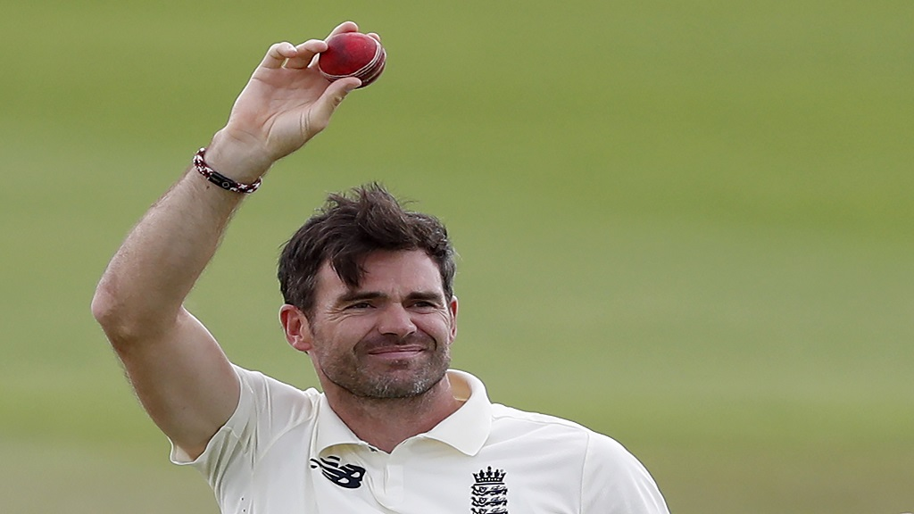 England's James Anderson holds up the ball to celebrate his 600th Test wicket after dismissing Pakistan's captain Azhar Ali during the fifth day of the third cricket Test, at the Ageas Bowl in Southampton, England, Tuesday, Aug. 25, 2020. (AP Photo/Alastair Grant, Pool).