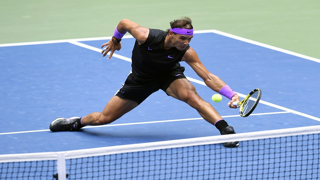 In this Sept. 8, 2019, file photo, Rafael Nadal, of Spain, returns a shot to Daniil Medvedev, of Russia, during the men's singles final of the US Open tennis championships in New York. Defending champion Rafael Nadal will skip the US Open because of the coronavirus pandemic. (AP Photo/Sarah Stier, File).