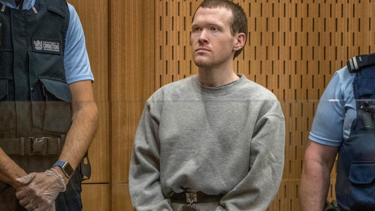 Twenty-nine-year-old Australian Brenton Harrison Tarrant stands in the dock at the Christchurch High Court for sentencing after pleading guilty to 51 counts of murder, 40 counts of attempted murder and one count of terrorism in Christchurch, New Zealand, Monday, Aug. 24, 2020. (John Kirk-Anderson/Pool Photo via AP)