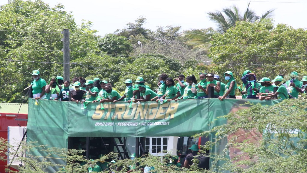 Labourites gather ahead of the start of the party's tour of Clarendon on Friday.