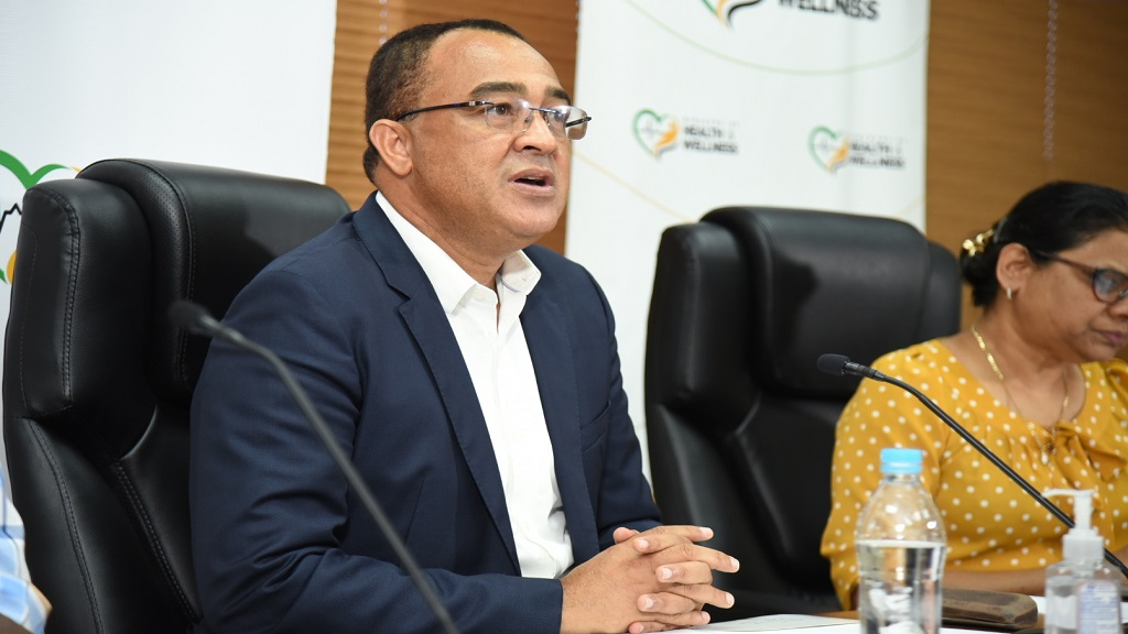 Health and Wellness Minister, Dr Christopher Tufton, and Chief Medical Officer, Dr Jacquiline Bisasor-McKenzie (partly hidden). (File photo)