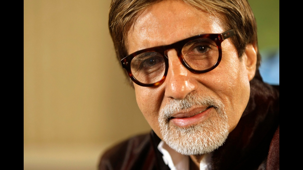 In this November 10, 2009 file photo, Bollywood superstar Amitabh Bachchan speaks during an interview in London. Bachchan was discharged from a Mumbai hospital on Sunday after undergoing two weeks of treatment for the coronavirus.(AP Photo/Alastair Grant, File)