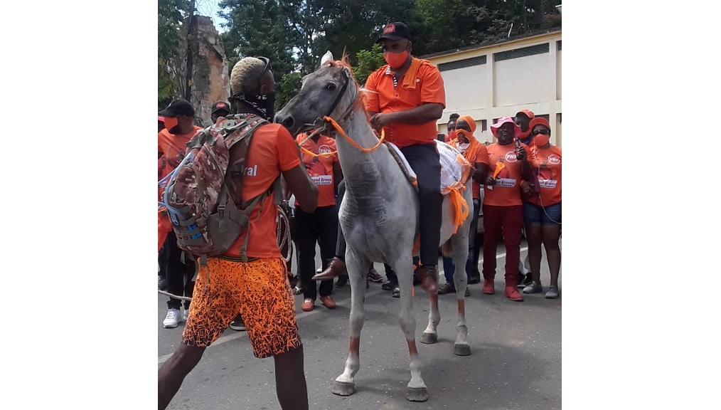 The People's National Party (PNP) candidate for North Central Clarendon, Dr Desmond Brennan, entering the nomination centre in style Tuesday.