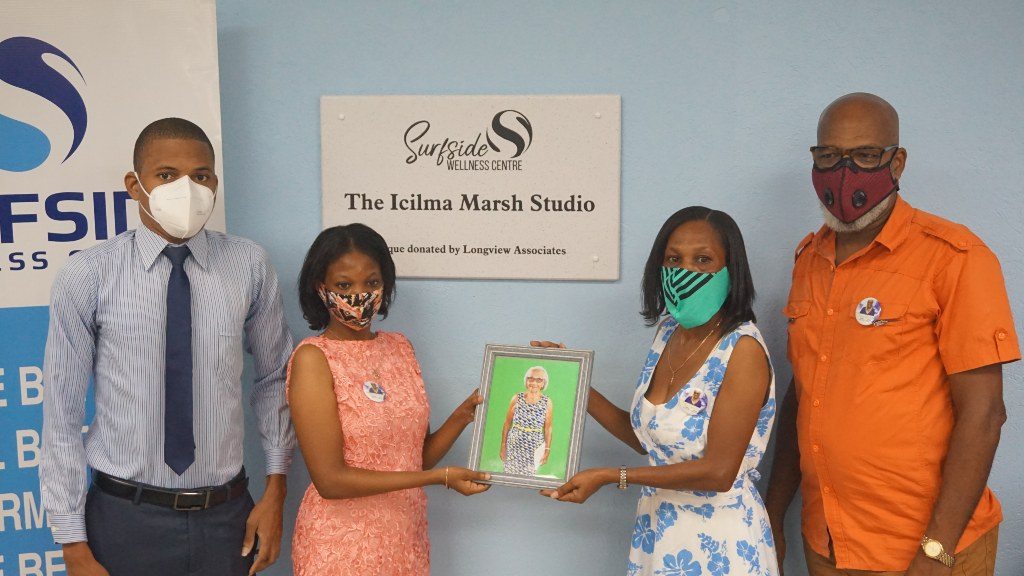 Family of the late Icilma Marsh pose by the plaque unveiled in honor at Surfside Wellness Center in Wildey