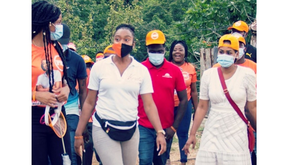 In this photo posted to the Facebook page of Kystal Tomlinson (second left), the PNP's West Rural St Andrew candidate is shown touring the constituency with party members, among them, PNP treasurer Lisa Hanna.