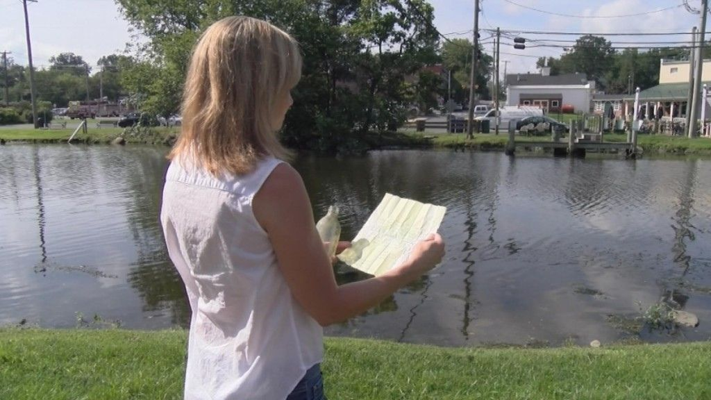 Cathi Riddle, who co-wrote the message in a bottle, re-reads it for the first time since her and cousin Stacey Wells tossed it in the Prime Hook Beach on August 1, 1985.