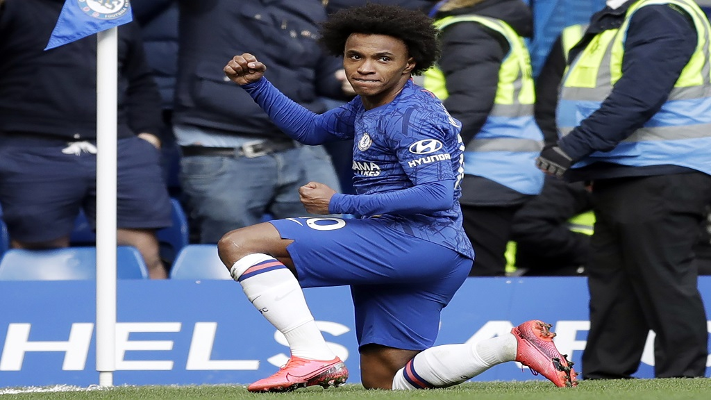 In this Sunday, March 8, 2020 file photo, Chelsea's Willian celebrates after scoring a goal during their English Premier League football match against Everton at Stamford Bridge stadium in London.  (AP Photo/Matt Dunham, file).