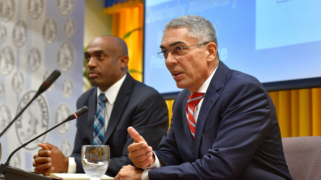 Governor of the Bank of Jamaica Richard Byles (right) makes a point at a press briefing. Also pictured is deputy governor Dr Wayne Robinson (left)