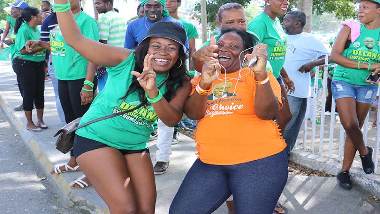 JLP and PNP supporters in Eastern St Thomas sharing some good vibes during Nomination Day for the 2016 general elections. (File Photo)