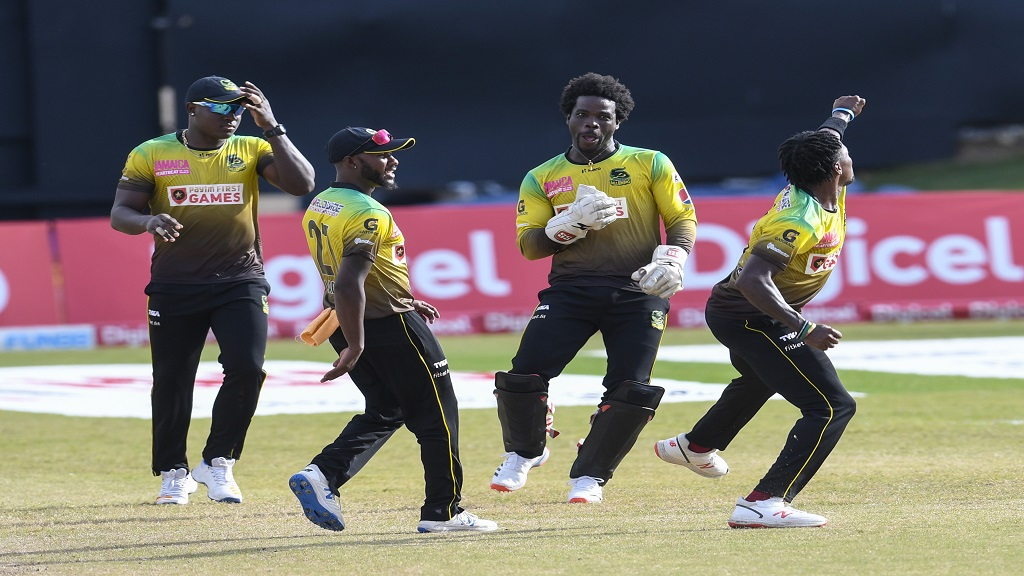 Jamaica Tallawahs' fast bowler Fidel Edward (right) celebrates along with teammates after bowling opener Chris Lynn of St Kitts and Nevis Patriot in the 18th match of the Hero Caribbean Premier League at Queen's Park Oval in Port-of-Spain, Trinidad and Tobago on Saturday, August 29, 2020. (Photo by Randy Brooks - CPL T20/CPL T20 via Getty Images).