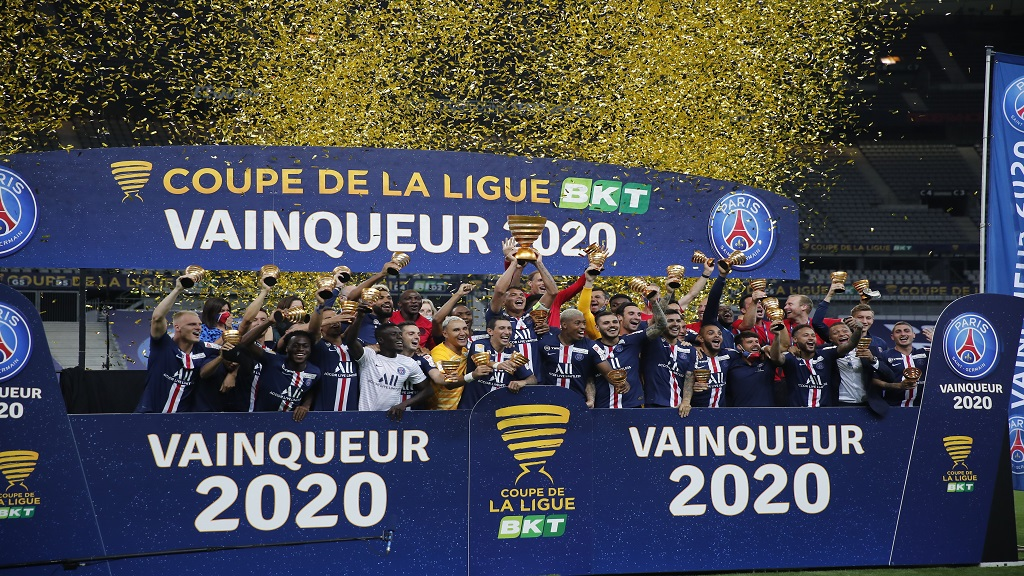 PSG's players celebrate after winning the French League Cup, following the final against Lyon at Stade de France stadium, in Saint Denis, north of Paris, Friday, July 31, 2020. (AP Photo/Francois Mori).