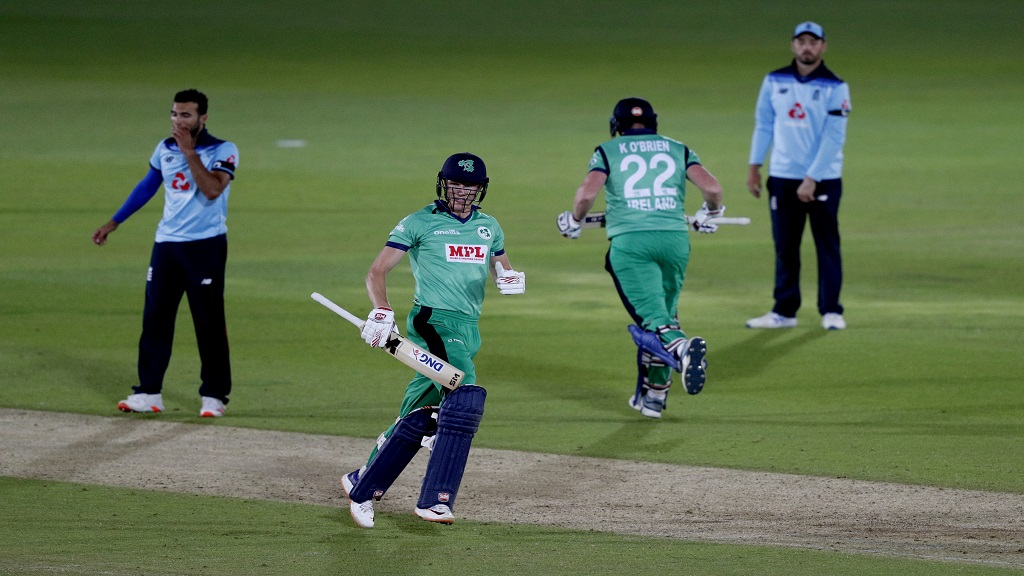 Ireland's Harry Tector, second left, celebrates with Kevin O'Brien after getting the runs to win the third One Day International cricket match against England at the Ageas Bowl in Southampton, England, Tuesday Aug. 4, 2020. (Adrian Dennis/Pool via AP).