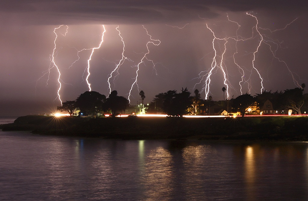 A rare lightning storm crackles over Mitchell's Cove in Santa Cruz, California around 3 am Sunday morning August 16, 2020. The severe storm system rolled through the San Francisco and Monterey Bay areas early Sunday, packing a combination of dry lightning and high winds that triggered wildfires throughout the region. The National Weather Service on Sunday extended a red flag fire warning for the entire Bay Area until 11 am Monday morning. (Shmuel Thaler/The Santa Cruz Sentinel via AP)
