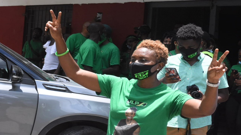 Jamaica Labour Party candidate for West Rural St Andrew, Juliet Cuthbert-Fynn, greets supporters by raising the JLP's V-sign after being nominated on Tuesday. (Photo: Marlon Reid)