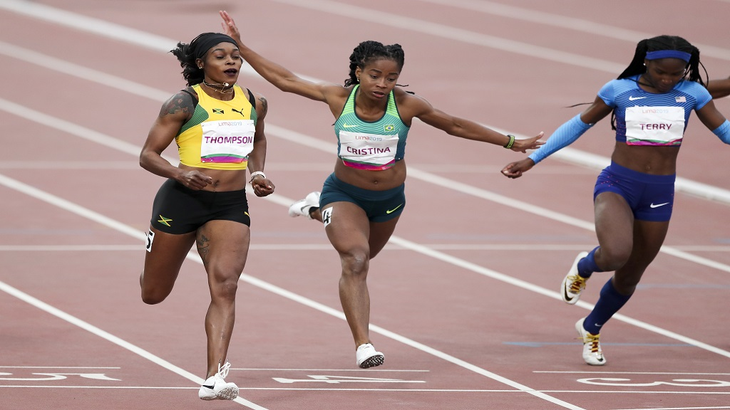 Elaine Thompson (left) competes in the women's 100m at the 2019 Pan Am Games in Lima, Peru.