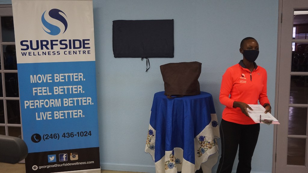 Sursfide Wellness Centre programme director Georgina Naigaga delivering remarks at plaque unveiling for Icilma Marsh.