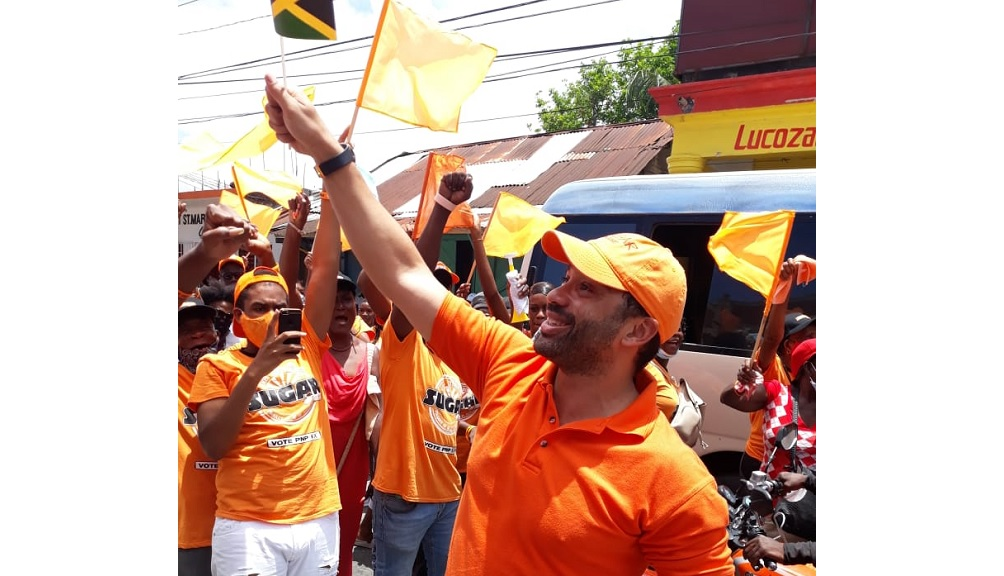 People's National Party (PNP) candidate for South East St Mary, Dr Shane Alexis with cheering supporters after being nominated on Tuesday.
