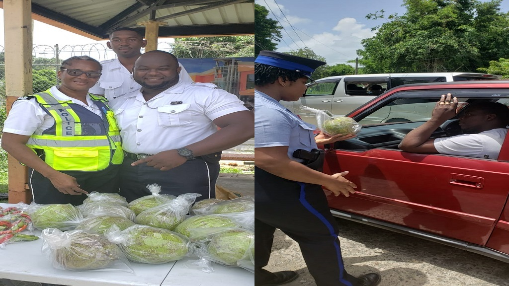 Police giving produce to motorists along the Ti Morne/Balata Highway