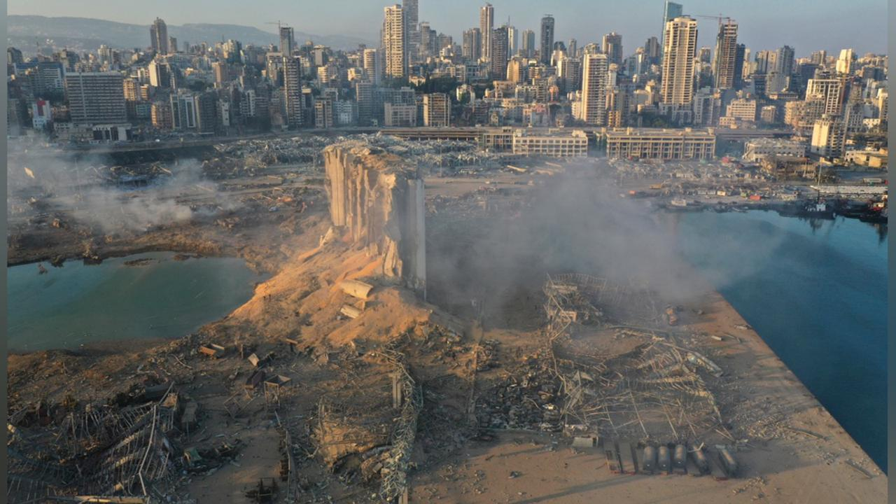 A drone picture shows the scene of an explosion at the seaport of Beirut, Lebanon, Wednesday, Aug. 5, 2020. A massive explosion rocked Beirut on Tuesday, flattening much of the city's port, damaging buildings across the capital and sending a giant mushroom cloud into the sky. More than 70 people were killed and 3,000 injured, with bodies buried in the rubble, officials said. (AP Photo/Hussein Malla)