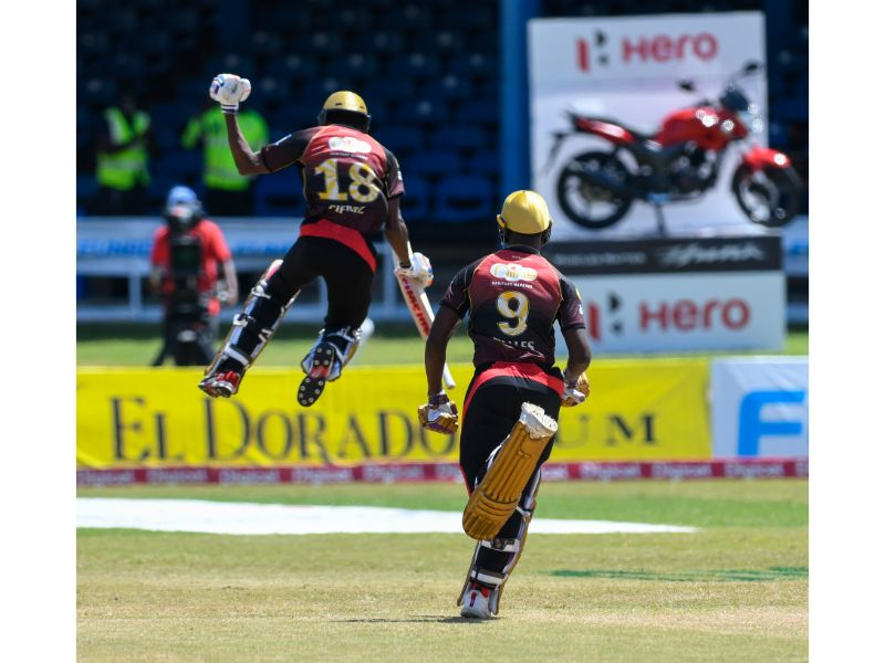 Khary Pierre (left) and Jayden Seales celebrate the Trinbago Knight Riders narrow win over the Barbados Tridents in Game 17 of the Hero Caribbean Premier League on 29th August 2020 at the Queen's Park Oval.  (Photo by Randy Brooks - CPL T20/Getty Images)