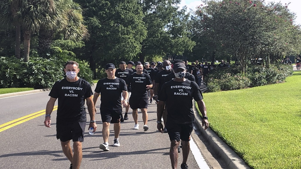 NBA referees march in support of players seeking an end to racial injustice in Lake Buena Vista, Fla., Thursday, Aug. 27, 2020. (AP Photo/Brian Mahoney).
