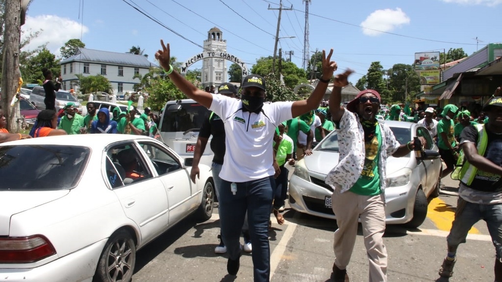 Jamaica Labour Party  candidate for North Central Clarendon, Robert Nesta Morgan raises the JLP's V-sign after being nominated on Tuesday.